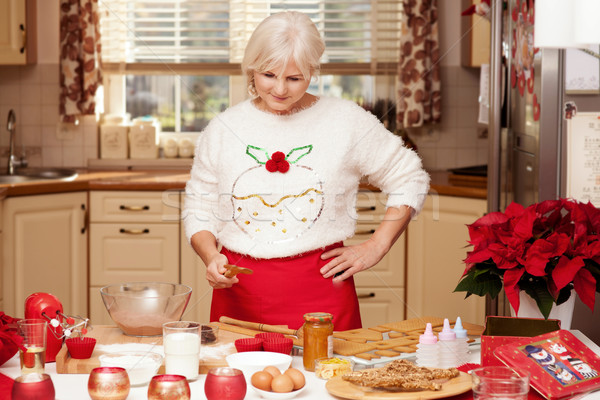 Pretty grandmother in kitchen, christmas time. Stock photo © NeonShot