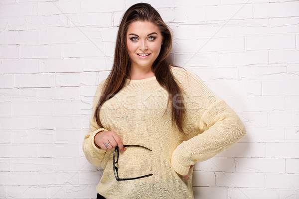 Plus size model posing in studio. Stock photo © NeonShot
