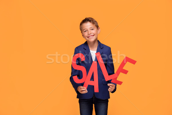 Littl elegant boy with sale letters. Stock photo © NeonShot