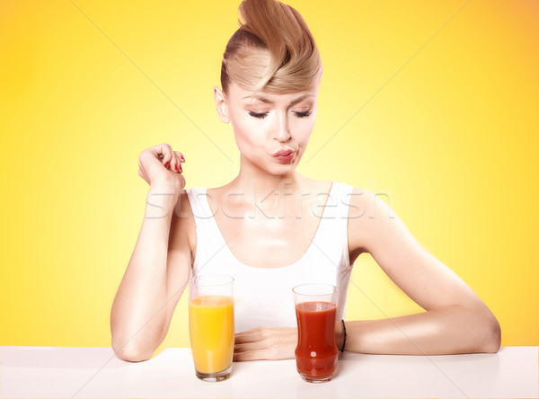 Attractive blonde woman with fruit juice. Stock photo © NeonShot