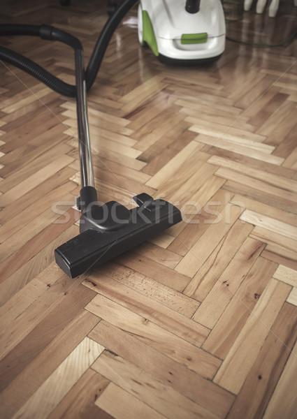 Vacuum cleaner on parquet Stock photo © nessokv