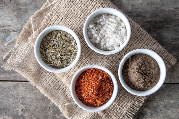 pepper, oregano and cooking salt in bowls Stock photo © nessokv