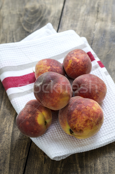 fresh peaches on wooden table Stock photo © nessokv