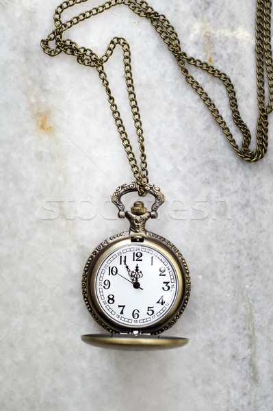 Pocket watch with  chain on marble. Stock photo © nessokv