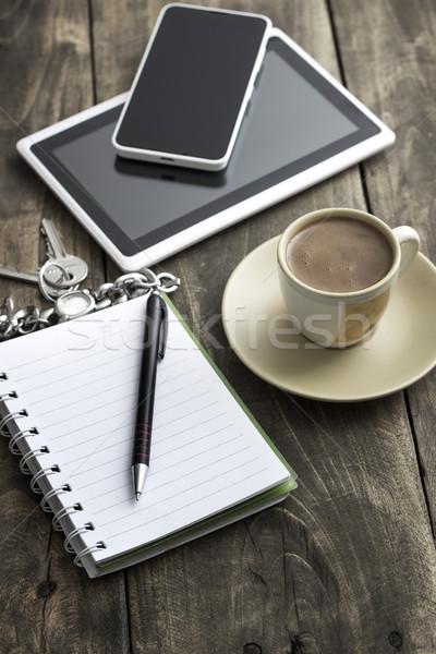 Mobile lavoro telefono Cup caffè Foto d'archivio © nessokv
