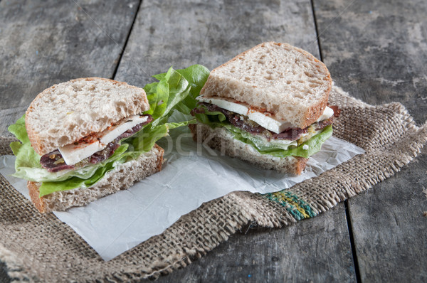 сэндвич копченый мяса старые деревянный стол продовольствие Сток-фото © nessokv