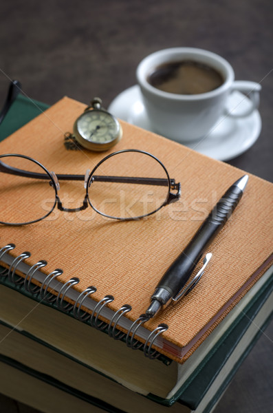 Stack of books and a pair of glasses on top of it.  Stock photo © nessokv