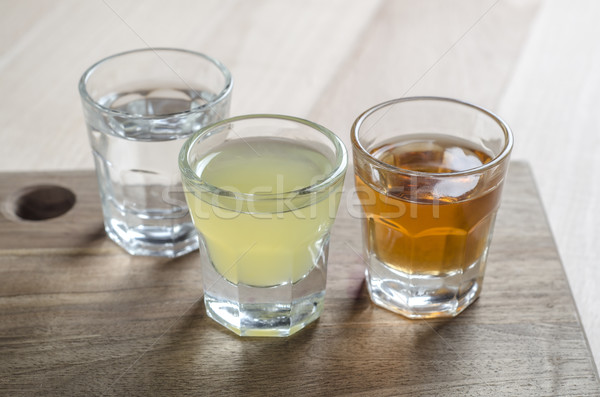 Glass of alcohol on wooden background Stock photo © nessokv