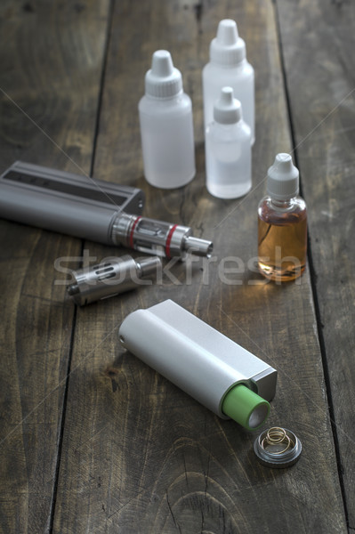 E-cigarettes with lots of different re-fill bottles Stock photo © nessokv