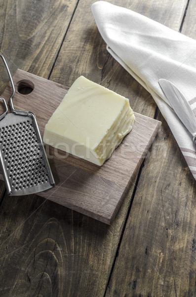 Cheese and grater on a wooden  kitchen table Stock photo © nessokv