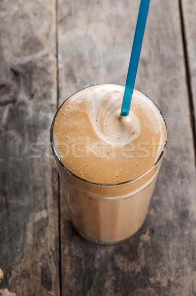 cold Frappe drink on a wooden table Stock photo © nessokv