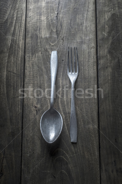Old cutlery on wooden table Stock photo © nessokv