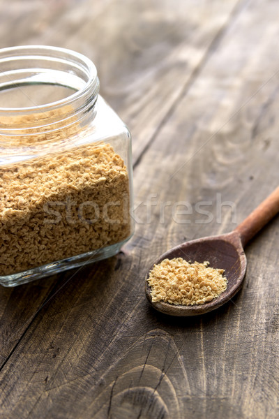 raw soy flakes in wooden spoon Stock photo © nessokv