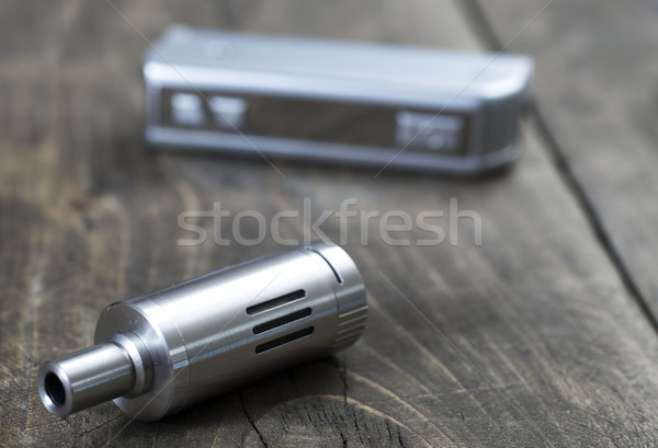 electronic cigarette on old wooden table Stock photo © nessokv