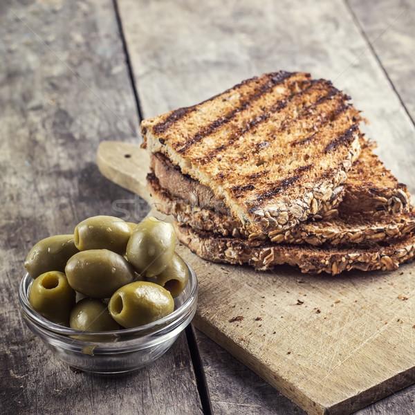 Geroosterd brood olijven tabel zwarte Stockfoto © nessokv