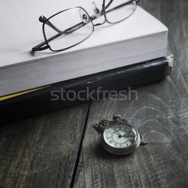 pocket watch glasses and  books  on wooden background Stock photo © nessokv