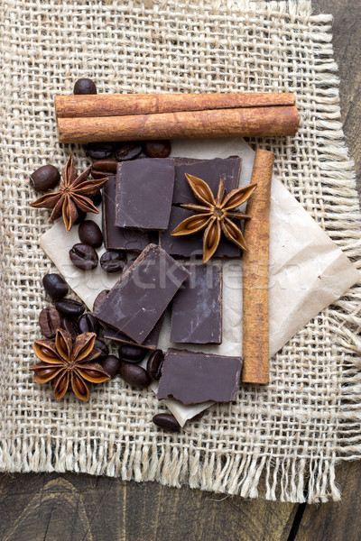 Chocolate crumbs, star anise and cinnamon sticks. Stock photo © nessokv