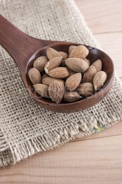 Almonds kernel in awooden spoon Stock photo © nessokv