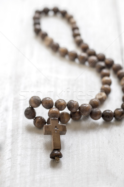 Wooden rosary beads and cross Stock photo © nessokv