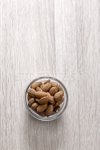 Bowl with almonds Stock photo © nessokv