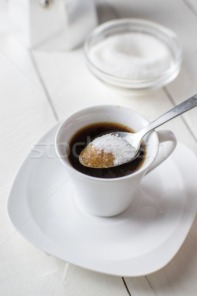 Pouring sugar on coffee cup. Stock photo © nessokv