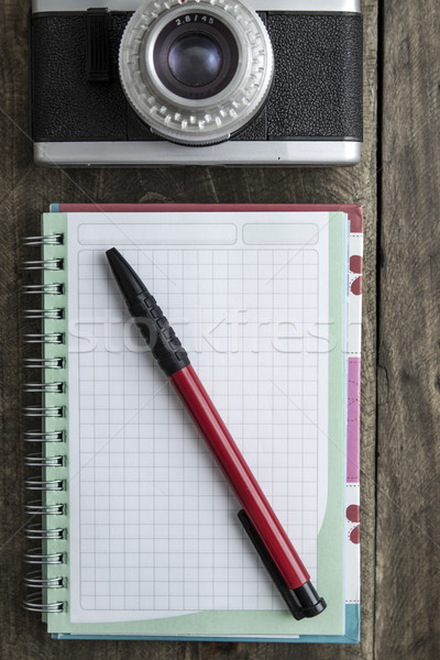 Blank notebook with  pen and retro camera on wooden table Stock photo © nessokv