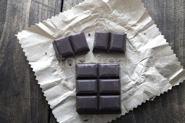 Noble dark chocolate on a wooden table Stock photo © nessokv