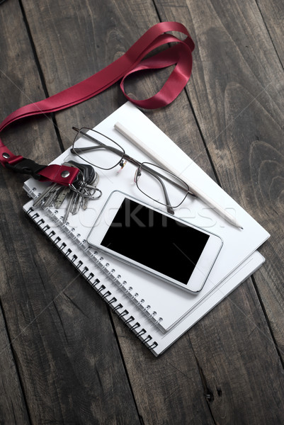 notebooks, reading glasses, smart phone, pen on a wooden table Stock photo © nessokv