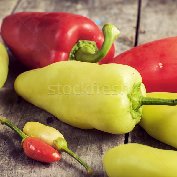 Piros paprika öreg fa asztal friss piros zöld Stock fotó © nessokv