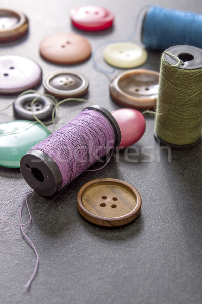 Stock photo: sewing thread and buttons