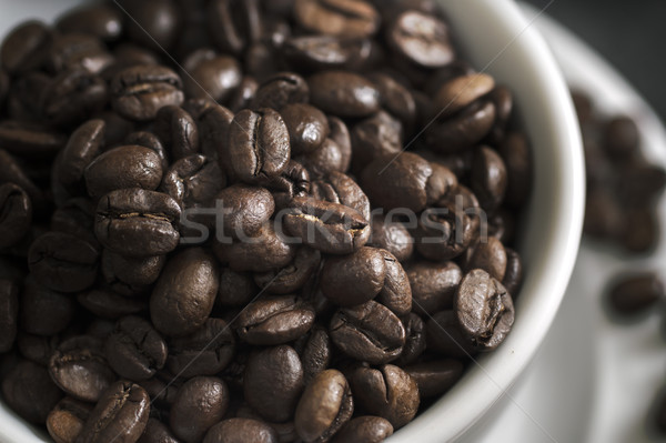 Coffee cup overflowing with  coffee beans Stock photo © nessokv
