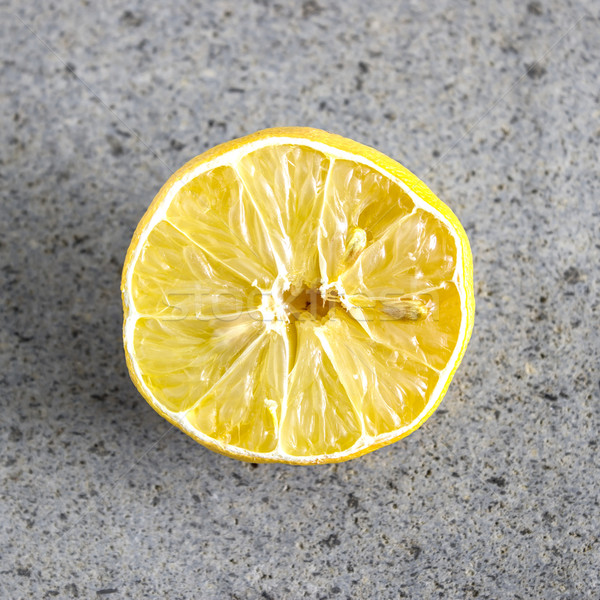 Withered Half Lemon on old table Stock photo © nessokv