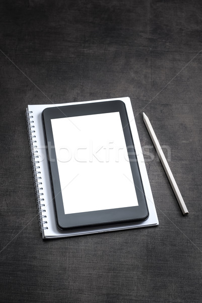White blank screen on the tablet pc on wooden background Stock photo © nessokv