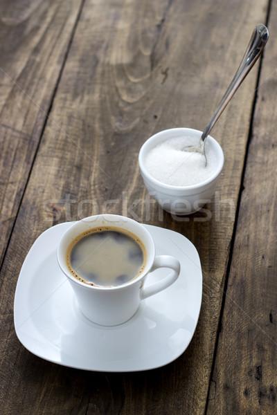 Foto stock: Copo · café · raio · mesa · de · madeira · fundo