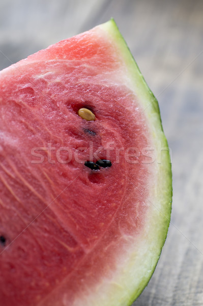Slice of watermelon on wooden table Stock photo © nessokv
