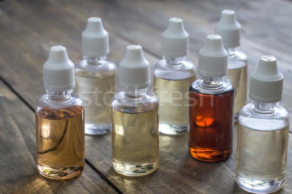различный бутылок сигарету жидкость концепция Сток-фото © nessokv