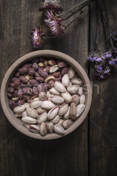 Peanuts and Pistachios in wooden bowl Stock photo © nessokv