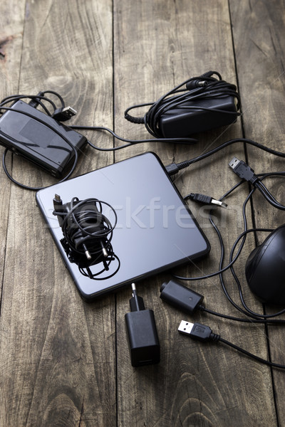Battery charger and wires tech mess Stock photo © nessokv