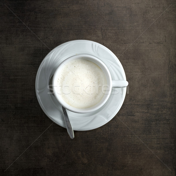 Cappuccino in cup on rustic  wooden background Stock photo © nessokv