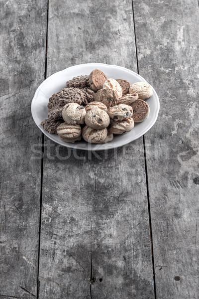 Cookies пластина старые деревянный стол шоколадом Cookie Сток-фото © nessokv