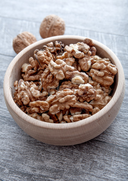 Walnuts in wooden bowl  Stock photo © nessokv