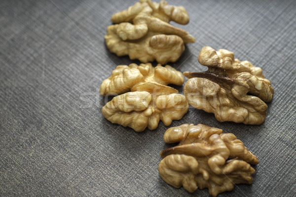 Walnuts on wooden table. Stock photo © nessokv