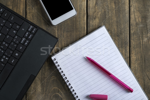Blank notepad, phone and  laptop  on office wooden table Stock photo © nessokv