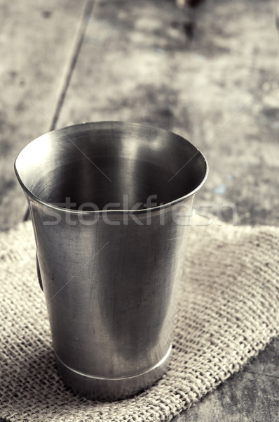 old metal cup on wooden table Stock photo © nessokv