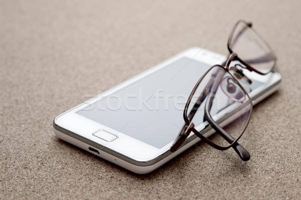 Mobiele telefoon bril boord Stockfoto © nessokv