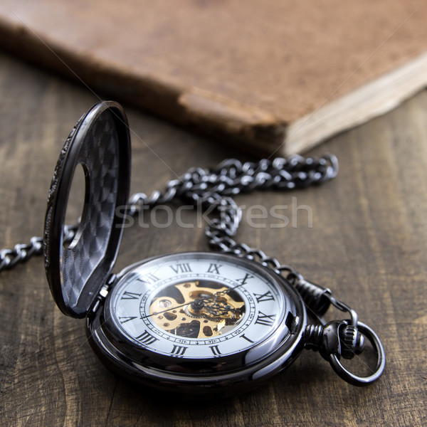 pocket watch over grunge wooden table Stock photo © nessokv