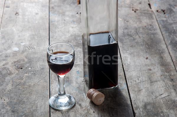 Cereza licor vidrio botella mesa de madera mesa Foto stock © nessokv