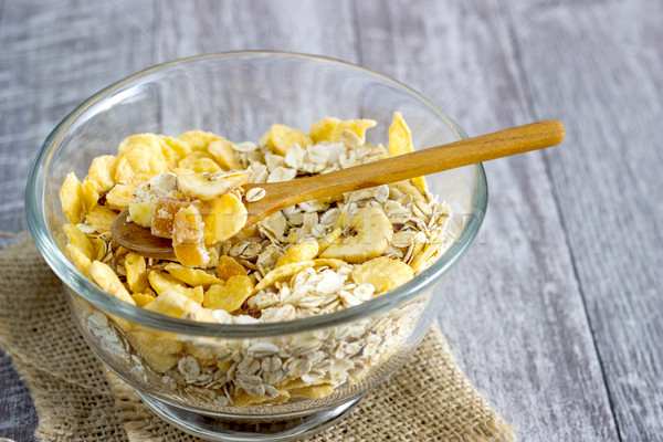 Oatmeal in a glass bowl on the table Stock photo © nessokv