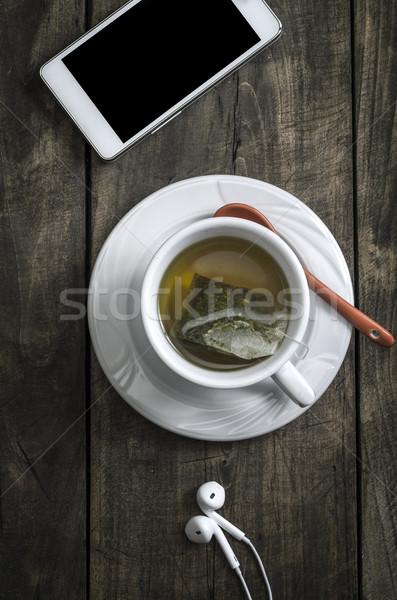 Copo inverno chá medicinal madeira telefone beber Foto stock © nessokv