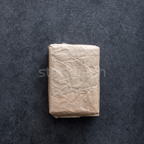 Package wrapped in wrinkled brown paper Stock photo © nessokv